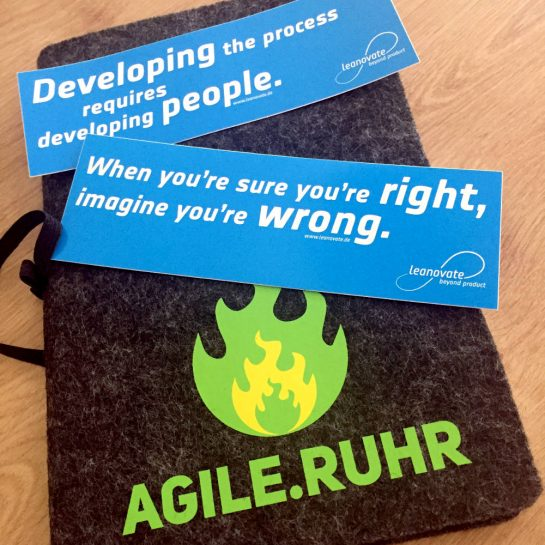 """Aufkleber: """"Developing the process requires developing people."""" - """"When you're sure you're right, imagine you're wrong."""""""